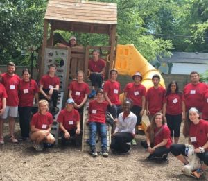 Landon Hackley and his work team restoring a playground while in Indianapolis at the NIC Conference.