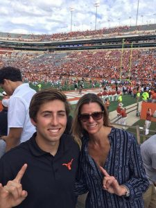 Grayland Jackson and his mom cheering on the Longhorns.